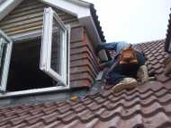 Tiler working on roof.JPG